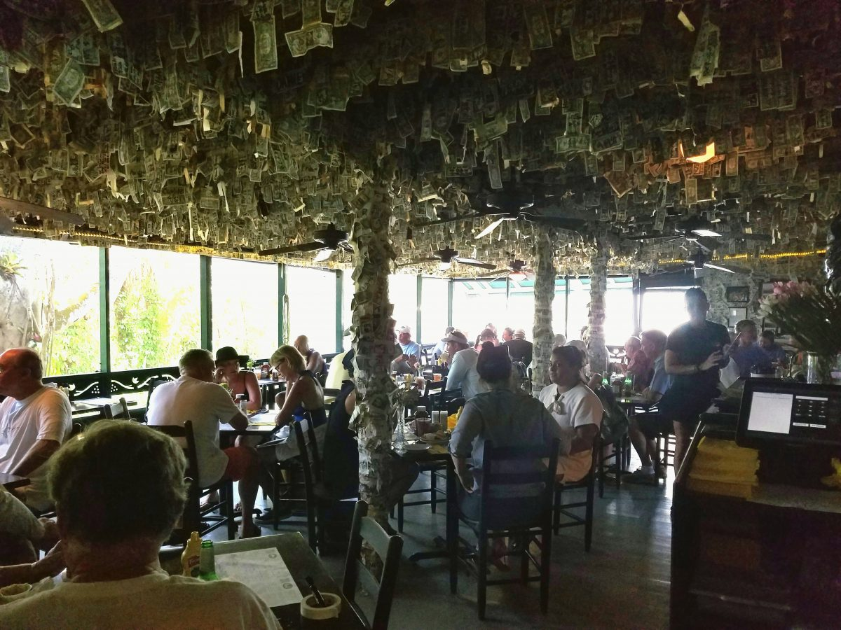 Cabbage Key Inn & Restaurant is a homey restaurant with seafood and a quirky decor of dollars on the ceilings and walls.