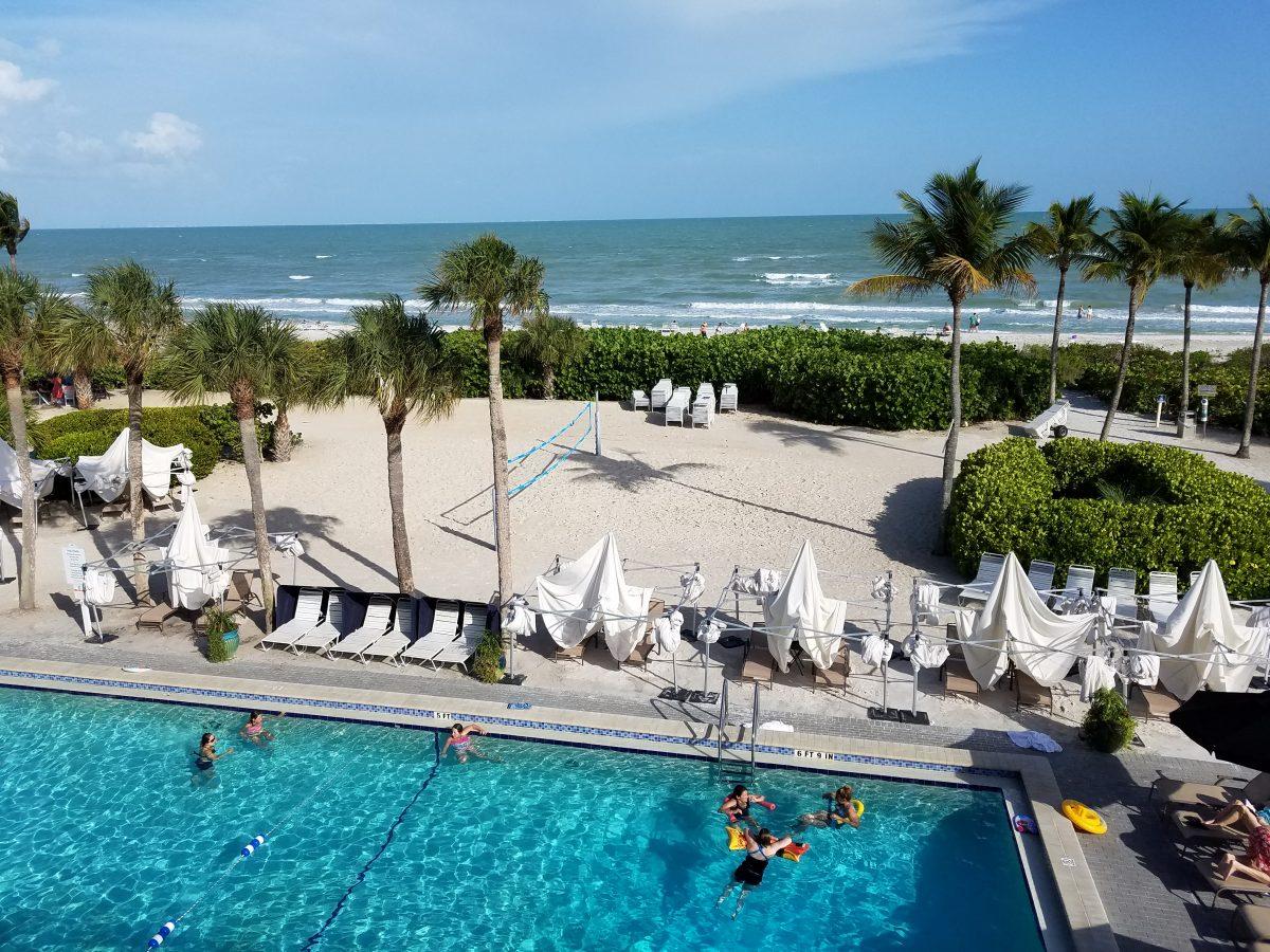 Pool, beach volleyball, ocean, and pool bar at Sundial Beach Resort & Spa on Sanibel Island